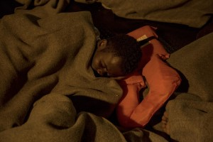 A migrant sleeps on board of German NGO Sea-Watch ship after his rescue in the Mediterranean Sea on November 6, 2017. During the shipwreck November 6,2017 five people died, including a newborn child. According to Sea-Watch, which has saved 58 migrants, the violent behavior of the Libyan coast guard caused the death of five persons. Sea-Watch is a non-governmental organisation founded on May, 19 2015 and is formally registered as a non-profit organisation in Berlin.