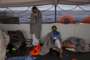 Migrants are seen on board of German NGO Sea-Watch ship after their rescue in the Mediterranean Sea on November 7, 2017. During the shipwreck November 6,2017 five people died, including a newborn child. According to Sea-Watch, which has saved 58 migrants, the violent behavior of the Libyan coast guard caused the death of five persons. Sea-Watch is a non-governmental organisation founded on May, 19 2015 and is formally registered as a non-profit organisation in Berlin.