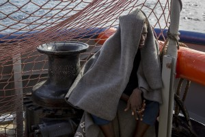 A migrant is seen on board of German NGO Sea-Watch ship after his rescue in the Mediterranean Sea on November 7, 2017. During the shipwreck November 6,2017 five people died, including a newborn child. According to Sea-Watch, which has saved 58 migrants, the violent behavior of the Libyan coast guard caused the death of five persons. Sea-Watch is a non-governmental organisation founded on May, 19 2015 and is formally registered as a non-profit organisation in Berlin.