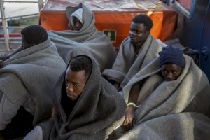Migrants are seen on board of German NGO Sea-Watch ship after their rescue in the Mediterranean Sea on November 8, 2017. During the shipwreck November 6,2017 five people died, including a newborn child. According to Sea-Watch, which has saved 58 migrants, the violent behavior of the Libyan coast guard caused the death of five persons. Sea-Watch is a non-governmental organisation founded on May, 19 2015 and is formally registered as a non-profit organisation in Berlin.