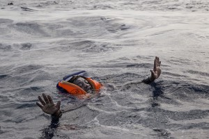 A migrant tries to board a boat of the German NGO Sea-Watch in the Mediterranean Sea on November 6, 2017. During a shipwreck, five people died, including a newborn child. According to the German NGO Sea-Watch, which has saved 58 migrants, the violent behavior of the Libyan coast guard caused the death of five persons. Alessio Paduano
