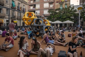 People are seen in Plaza del Sol, in Barcelona, Spain on July 8, 2018.