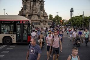 People walk in Plaza Colon in Barcelona, Spain on July 12, 2018.