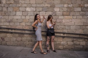Girls have fun in a street of the Raval district in Barcelona, Spain on July 12, 2018. The Raval is one of the most multicultural and colorful neighborhoods in the city and it hosts numerous artists and galleries.
