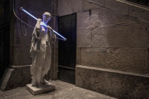 A statue holding a neon is seen in a street of Barcelona, in Spain on July 5, 2018.
