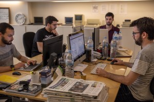 "Journalists at work inside the editorial office of ""Vilaweb"" in the Raval district in Barcelona, Spain on July 12, 2018. ""Vilaweb"" is a Catalan-language web portal and daily news outlet founded in May 1995. The Raval is one of the most multicultural and colorful neighborhoods in the city and it hosts numerous artists and galleries."