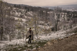 A migrant walks in a wood in the outskirts of the Bosnian city of Bihać, Bosnia and Herzegovina on November 28, 2018.