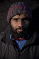 Amanullah, 23 years old from Gujrat, Pakistan is portrayed outiside a reception center in Velika Kladusa, Bosnia and Herzegovina on November 30, 2018.