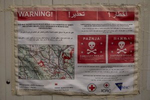 A map showing the dangerous areas contaminated by mines and other unexploded ordnance is attached on a wall of an abandoned building where migrants take refuge in the outskirts of the Bosnian city of Bihać, Bosnia and Herzegovina on November 29, 2018.