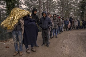 Afghans and Pakistanis migrants lined up during the food distribution near a park in Bihać, Bosnia and Herzegovina on November 28, 2018.