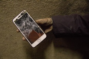 A migrant shows a mobile phones that, according to him, was destroyed by the Croatian police in Velika Kladusa, Bosnia and Herzegovina on November 30, 2018.