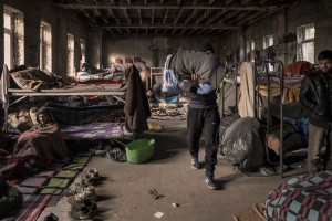 Migrants are seen inside an abandoned building where they took refuge in the outskirts of the Bosnian city of Bihać, Bosnia and Herzegovina on December 2, 2018.