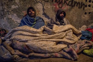 Migrants rest inside an abandoned building where they took refuge in the outskirts of the Bosnian city of Bihać, Bosnia and Herzegovina on November 28, 2018.