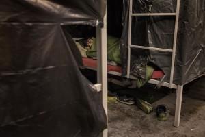 A migrant sleeps inside a reception center in Velika Kladusa, Bosnia and Herzegovina on November 30, 2018.