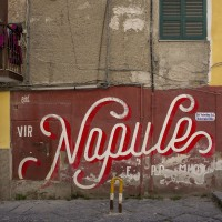 "A mural with the famous slogan ""Vir Napule e po muor"" (see Naples and then die) realized by the French brothers Toqué is seen in a street of Sanità district, in Naples, Italy on April 9, 2019."