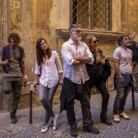 """Tourists during the street art tour organized by the cultural association """"400 ml"""" in Naples, Italy on March 24, 2019. Napoli Paint Stories street art and graffiti tour is a touristic walk in the neapolitan historical center through murales,stencils,slogans,posters and graffiti to discover urban art."""