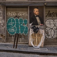 """A mural realized by the French artist """"Blase"""" is seen in a street of the historical center of Naples, in Italy on March 22, 2019."""