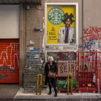 "A portrait of the Neapolitan artist ""Roxy in the box"" near a work realized by her depicting the American writer and painter Jean-Michel Basquiat in Naples, Italy on March 22, 2019."