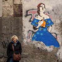 "A portrait of the Neapolitan artist ""Roxy in the box"" near a work realized by her depicting the American soprano Maria Callas in Naples, in Italy on March 22, 2019."