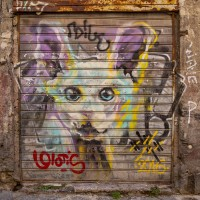 """A mural of the Italian street artist """"Walter Molli """" is seen in the alleys of the historical center of Naples, Italy on March 24, 2019."""