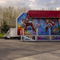 Carousel in the middle of Giovanni Paolo II square in Scampia district, in Naples, Italy on March 9, 2019.