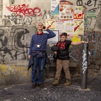"""Tourists during a street art tour organized by the cultural association """"400 ml"""" in Naples, Italy on March 24, 2019. Napoli Paint Stories streetart and graffiti tour is a touristic walk in the neapolitan historical center through murales, stencils, slogans, posters and graffiti to discover urban art."""