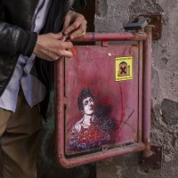 """A graffiti of the French street artist """"C215"""" in the street of the historical center of Naples, Italy on March 24, 2019."""