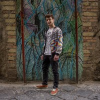 Matteo, 22 years old is portrayd in the alleys of the historical center of Naples, in Italy on April 10, 2019. He thinks that street art is positive except in the case where  monuments are damaged.