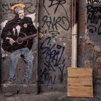 "A stencil of the Italian street artist ""TvBoy"" depicting the Neapolitan singer Pino Daniele in the alleys of the historical center of Naples, in Italy on March 24, 2019."