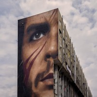 """A mural depicting the revolutionary Che Guevara realized by the Italian street artist """"Jorit"""" is seen on a palace of S an Giovanni a Teduccio, near Naples, in Italy on May 9, 2019."""