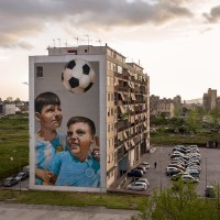 "The mural entitled ""Chi è vulut bene, nun so scorda"" (whoever is loved, doesn't forget it) realized by the Italian street artists ""Rosk&Loste"" on the facade of a palace inside the so called ""Park of murals"" in Ponticelli, near Naples, Italy on April 8, 2019. An artistic redevelopment and social regeneration program promoted by INWARD (observatory on urban creativity) has been starting since 2015."