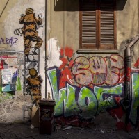 A mural of the Italian street artist and photographer Eduardo Castaldo in the alleys of the historical center of Naples, Italy on March 24, 2019.