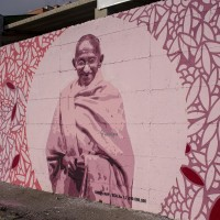 "A mural depicting Mahatma Gandhi, who was an Indian politician, philosopher and lawyer, in Scampia district, Naples, Italy on April 9, 2019. The mural is located near the ""garden of non-violence and the five continents"" and is part of a project realized by ""Raro"" and Fabio della Ratta ""biodpi"",  with the collaboration of three boys from Gambia."