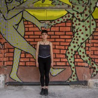 """Serena, 19 years old is portrayed inside the cultural center """"Santa Fede Liberata"""" in Naples, Italy on April 10, 2019. She almost always likes street art, except in some cases, for example on the trains, bus, etc."""