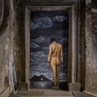 """The mural entitled """"the wind weighs as much as the chains"""" realized by the French street artist """"Zilda"""" is seen inside San Felice palace, in Naples, Italy on April 10, 2019."""