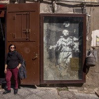 "A woman is seen near the moural known as ""Madonna with the gun"" of the English street artist Banksy in Naples, Italy on March 24, 2019. ""Madonna with the gun"" is the only work in Italy realized by Banksy."