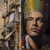 """A mural depicting Saint Januarius realized by the Italian street artist """"Jorit"""" is seen on the facade of a palace in the historical center of Naples, in Italy on March 19, 2019. Januarius was a bishop and a Christian martyr. He is venerated as a saint by the Catholic Church and the Orthodox Church and is considered the saint patron of Naples."""