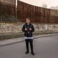 """Tommaso is portrayed near the """"garden of non-violence and the five continents"""" in Scampia district, Naples, Italy on March 9, 2019. Tommaso hopes that the new murals realized in Scampia will not be ruined by dull acts of vandalism."""