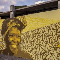 "A mural depicting Wangari Muta Maathai, who was a Kenyan environmentalist, political activist and biologist in Scampia district, Naples, Italy on March 9, 2019. The mural is located near the ""garden of non-violence and the five continents"" and is part of a project realized by ""Raro"" and Fabio della Ratta ""biodpi"",  with the collaboration of three boys from Gambia."