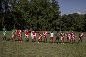 "Players of ""Semuthu Thoduwawa"" team are seen before a match of ""elle"" in Naples, Italy on September 29, 2019. Every Sunday hundreds of people belonging to the Sri Lankan community in Italy gather in the ""Real Bosco di Capodimonte"" of Naples and play ""elle"", a very popular Sri Lankan bat-and-ball game, often played in rural villages and urban areas."