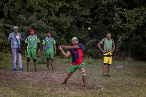 "A moment of a match of ""elle"" in Naples, Italy on September 29, 2019. Every Sunday hundreds of people belonging to the Sri Lankan community in Italy gather in the ""Real Bosco di Capodimonte"" of Naples and play ""elle"", a very popular Sri Lankan bat-and-ball game, often played in rural villages and urban areas."