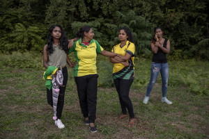 "Players are seen before a match of ""elle"" in Naples, Italy on September 29, 2019. Every Sunday hundreds of people belonging to the Sri Lankan community in Italy gather in the ""Real Bosco di Capodimonte"" of Naples and play ""elle"", a very popular Sri Lankan bat-and-ball game, often played in rural villages and urban areas."