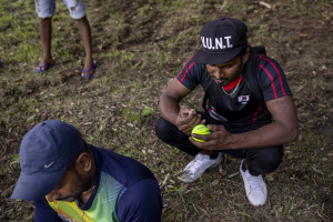 "A player prepares a ball removing the fur before a match of ""elle"" in Naples, Italy on September 29, 2019. Every Sunday hundreds of people belonging to the Sri Lankan community in Italy gather in the ""Real Bosco di Capodimonte"" of Naples and play ""elle"", a very popular Sri Lankan bat-and-ball game, often played in rural villages and urban areas."