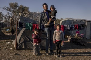 Hassan, 31 years old from Syria is portryed with his three sons Husam, Ola and Ghufran inside the Moria refugee camp where they have lived for three months on the island of Lesbos in Greece on February 18, 2020. About 20000 migrants and asylum seekers – mostly coming from Afghanistan and Syria – live in the official Moria camp and in the olive grove that is located nearby.