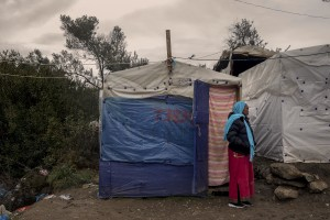 A Somali woman is seen outside the tent where she lives in the Moria refugee camp on the island of Lesbos in Greece on February 20, 2020. About 20000 migrants and asylum seekers – mostly coming from Afghanistan and Syria – live in the official Moria camp and in the olive grove that is located nearby.
