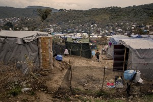 A child walks inside the Moria refugee camp on the island of Lesbos in Greece on February 20, 2020. About 20000 migrants and asylum seekers – mostly coming from Afghanistan and Syria – live in the official Moria camp and in the olive grove that is located nearby.