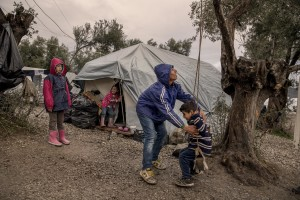 Children play with a swing inside the Moria refugee camp on the island of Lesbos in Greece on February 20, 2020. About 20000 migrants and asylum seekers – mostly coming from Afghanistan and Syria – live in the official Moria camp and in the olive grove that is located nearby.