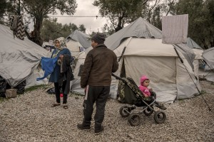 People from Afghanistan are seen inside the Moria refugee camp on the island of Lesbos in Greece on February 20, 2020. About 20000 migrants and asylum seekers – mostly coming from Afghanistan and Syria – live in the official Moria camp and in the olive grove that is located nearby.