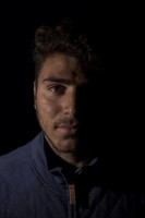 Ahmad, 18 years old from Afghanistan is portrayed inside the Moria refugee camp on the island of Lesbos in Greece on February 20, 2020.