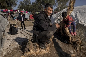 People are seen inside the Moria refugee camp on the island of Lesbos in Greece on February 18, 2020. About 20000 migrants and asylum seekers – mostly coming from Afghanistan and Syria – live in the official Moria camp and in the olive grove that is located nearby.